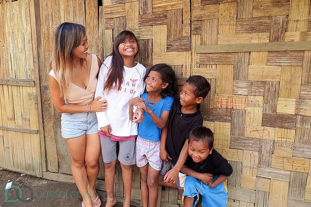 Outsourcing Ange's Co-founder Linh Podetti sharing love and laughs with kids from the Dumagat Tribe