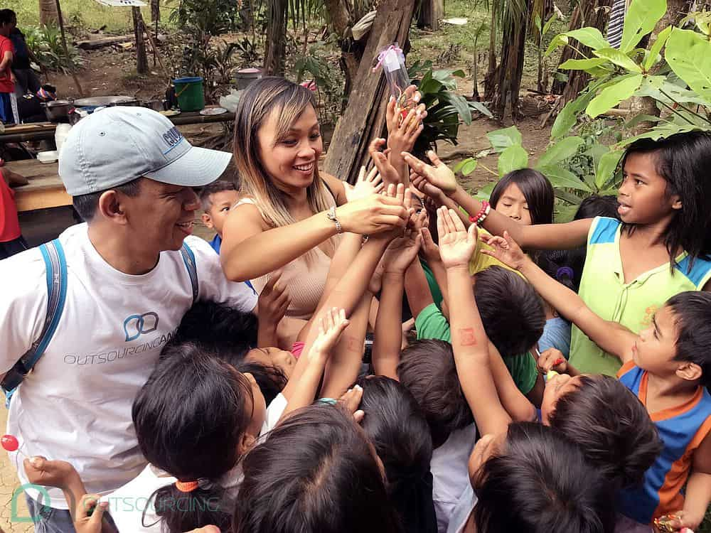 Outsourcing Angel's Co-founder, Linh Podetti, giving away toys to the excited kids of the Dumagat Tribe