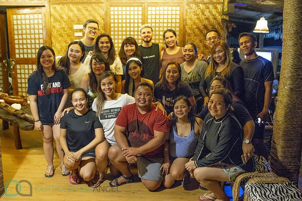 A family photo of Outsourcing Angel's Australian and Filipino teams on Samal Island